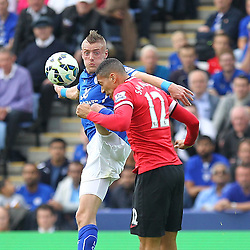 Leicester City's Jamie Vardy and Manchester United's Chris Smalling clash in tdhe air during the Barclays Premiership match between Leicester City FC and Manchester United FC, at the King Power Stadium, Leicester, 21st September 2014 © Phil Duncan | SportPix.org.uk