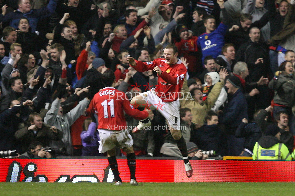 MANCHESTER, ENGLAND - SUNDAY, JANUARY 22nd, 2006: Manchester United's Wayne Rooney and Ryan Giggs clebrates Rio Ferdinand's winning goal against Liverpool during the Premiership match at Old Trafford. (Pic by David Rawcliffe/Propaganda)