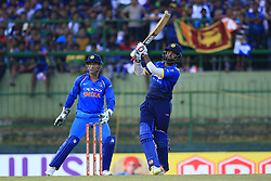 August 27, 2017 - Kandy, Sri Lanka - Sri Lankan cricketer Lahiru Thirimanne (R) plays a shot for a boundary as Indian wicket keeper MS Dhoni (L)  looks on during the 3rd One Day International cricket match between Sri Lanka and India at the Pallekele international cricket stadium at Kandy, Sri Lanka on Sunday 27 August 2017. (Credit Image: © Tharaka Basnayaka/NurPhoto via ZUMA Press)