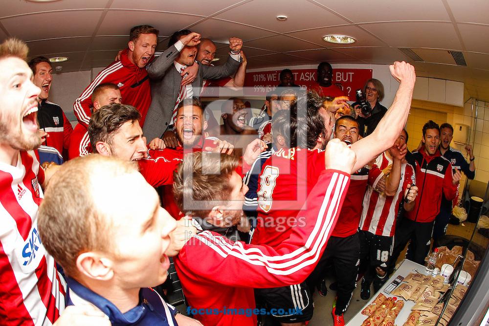 Brentford players celebrate promotion after the game against  Preston North End at Griffin Park, London<br /> Picture by Mark D Fuller/Focus Images Ltd +44 7774 216216<br /> 18/04/2014