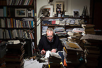 SOVERIA MANNELLI, ITALY - 17 NOVEMBER 2016: Mario Caliguri, 56, mayor of Soveria Mannelli for five mandates and now a University professor, edits his latest book in his studio in Soveria Mannelli, Italy, on November 17th 2016.<br /> <br /> Soveria Mannelli is a mountain-top village in the southern region of Calabria that counts 3,070 inhabitants. The town was a strategic outpost until the 1970s, when the main artery road from Naples area to Italy's south-western tip, Reggio Calabria went through the town. But once the government started building a motorway miles away, it was cut out from the fastest communications and from the most ambitious plans to develop Italy's South. Instead of despairing, residents benefited of the geographical disadvantage to keep away the mafia infiltrations, and started creating solid businesses thanks to its administrative stability, its forward-thinking mayors and a vibrant entrepreneurship numbering a national, medium-sized publishing house, a leading school furniture manufacturer and an ancient woolen mill.
