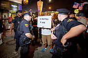"Hanif Phelps greets police with his sign "" U matter 2 me"". The Republican National Convention in Cleveland, where Donald Trump is nominated as the republican presidential candidate."