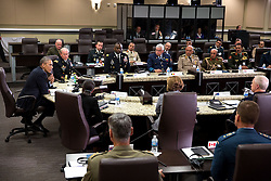 President Barack Obama participates in a meeting hosted by Gen. Martin E. Dempsey, Chairman of the Joint Chiefs of Staff, with foreign chiefs of defense to discuss the coalition efforts in the ongoing campaign against ISIL, at Joint Base Andrews, Md., Oct. 14, 2014. (Official White House Photo by Pete Souza)<br /> <br /> This official White House photograph is being made available only for publication by news organizations and/or for personal use printing by the subject(s) of the photograph. The photograph may not be manipulated in any way and may not be used in commercial or political materials, advertisements, emails, products, promotions that in any way suggests approval or endorsement of the President, the First Family, or the White House.