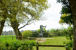 &copy; Licensed to London News Pictures. <br /> 23/4/2017. London, Great Britain.  <br /> Statue of naked Greek philosopher, Archimedes in the grounds of College Farm, Ellisfield, Basingstoke which is being objected to by residents who claim it is a distraction to drivers. <br /> Photo credit: Anthony Upton/LNP