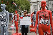 Selina Nwulu, young poet laureate for London at the  launch of ActionAid's International Safe Cities for Women Day at Marble Arch, with an interactive exhibition featuring a group of 30 mannequins, London.<br /> Picture date: Thursday May 19, 2016. A third of the mannequins featured in the installation will be marked in red, to represent the one in three women who experience violence in their lifetimes. But behind every statistic is a real woman, and on each mannequin are quotes from women around the world telling their experience of urban violence and the stories behind the statistics. ActionAid is campaigning for the UK government to commit to increasing the proportion of aid going directly to women's groups working on the frontline in poor communities. (photo by Andrew Aitchson/ActionAid)