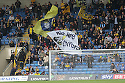 Oxford fans waving flags during the Sky Bet League 2 match between Oxford United and AFC Wimbledon at the Kassam Stadium, Oxford, England on 10 October 2015.