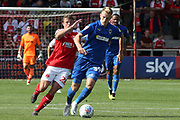 AFC Wimbledon striker Joe Pigott (39) fends off the challenge from Fleetwood Town midfielder Jack Sowerby (28) during the EFL Sky Bet League 1 match between Fleetwood Town and AFC Wimbledon at the Highbury Stadium, Fleetwood, England on 4 August 2018. Picture by Craig Galloway.