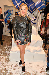 OLIVIA COX at a party to celebrate 'Kitmas' at Kit & Ace at 80-82 Regent Street, London on 9th December 2015.