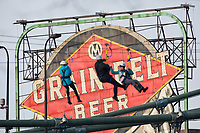 Minneapolis, MN - January 26, 2017: Bold North Zip Line participants zoom down the line, past the famous Grain Belt Beer sign and over the Mississippi River as part of the SuperBowl LII events taking place in Minneapolis.