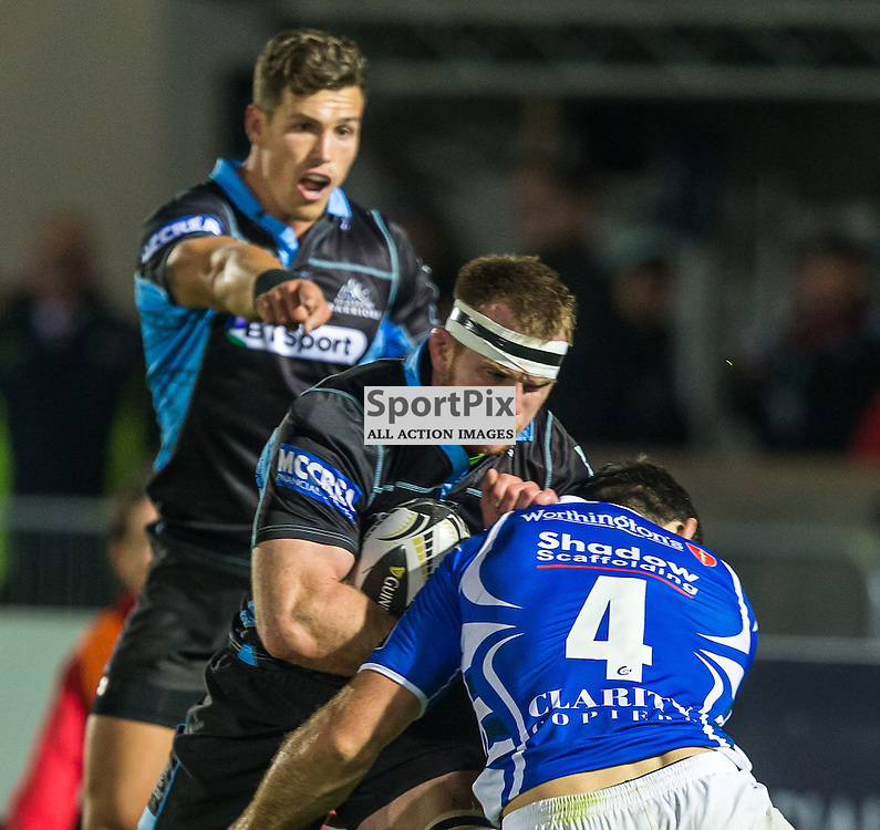 Chris Fusaro is tackled by Nick Crosswell during the Guinness Pro 12 match between Glasgow Warriors and Newport Dragons (c) ROSS EAGLESHAM | Sportpix.co.uk