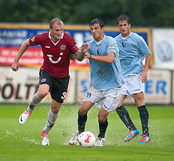24.07.2012, Thermenstadion, Bad Waltersdorf, AUT, Hannover 96 vs FC Rad, im Bild Konstantin Rausch, (Hannover 96, #34), Ognjen Gnjatic, (FC Rad, #19) // during Friendly Match, between Hannover 96 vs FC Rad at the Thermenstadion, Bad Waltersdorf, Austria on 2012/07/24. EXPA Pictures © 2012, PhotoCredit: EXPA/ Mario Kuhnke