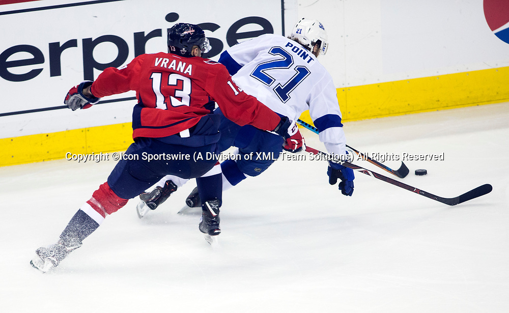 WASHINGTON, DC - MAY 21: Tampa Bay Lightning center Brayden Point (21) moves away from Washington Capitals left wing Jakub Vrana (13) in the third period during game 6 of the NHL Eastern Conference  Finals between the Washington Capitals and the Tampa Bay Lightning, on May 21, 2018, at Capital One Arena, in Washington D.C. The Caps defeated the Lightning 3-0<br /> (Photo by Tony Quinn/Icon Sportswire)