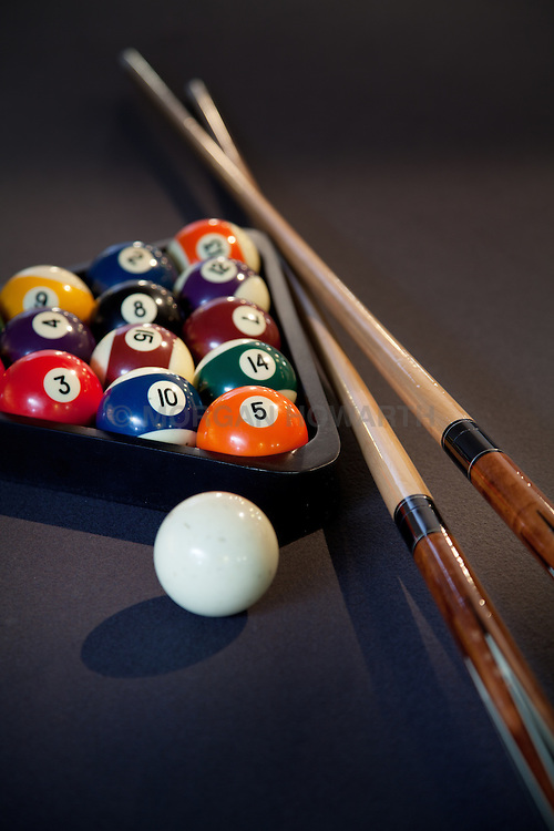 Pool table with pool balls cue sticks
