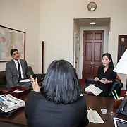 Representative Pramila Jayapal (D-WA, 7) eats lunch at her desk, while meeting with her Deputy chief of Staff, Ven Neralla, left, and Legislative Assistant, Jennifer Chan, on Tuesday, January 31, 2017.  John Boal photo/for The Stranger