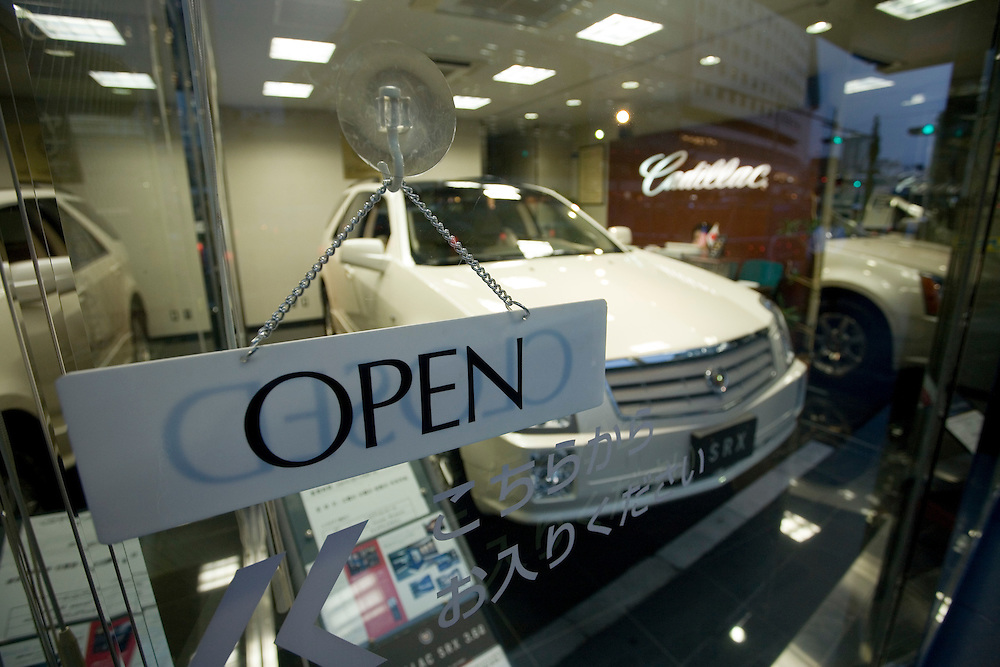 "General Motors in Japan.""the  toughest job in japan""  sales of GM cars in Japan  have  declined in recent years with only about 6000 units being sold last year...Tokyo showrooms  on is a cadillac one  car showroom in central tokyo  the other is  the Japanese distributors Main showroom showing  several GM models including CADILLAC  SABB  and HUMMER.."