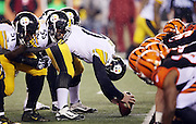 The Pittsburgh Steelers offensive line gets set for the snap opposite the line of scrimmage from the Cincinnati Bengals defensive line during the NFL AFC Wild Card playoff football game against the Cincinnati Bengals on Saturday, Jan. 9, 2016 in Cincinnati. The Steelers won the game 18-16. (©Paul Anthony Spinelli)
