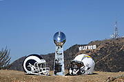General overall view of Los Angeles Chargers (left) and Los Angeles Rams (right) helmets and Lombardi Trophy (center) with the Hollywood sign and Mount Lee as a backdrop in Los Angeles, Wednesday, Sept. 19, 2018. After more than two decades without an NFL team, the Rams relocated from St. Louis in 2016 and the Chargers moved in 2017. The teams will share a stadium financed by Rams owner Stan Kroenke at the LA Stadium and Entertainment District in Inglewood, Calif. scheduled to be completed in 2020.