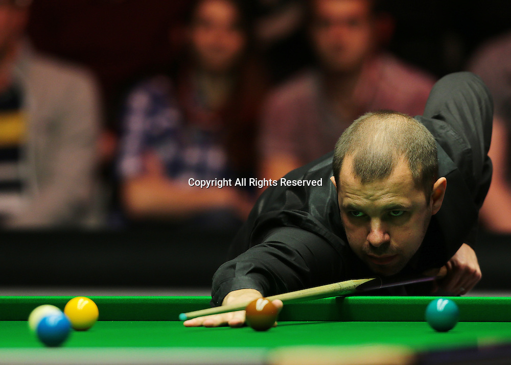 16.01.2016.  Alexandra Palace, London, England. Masters Snooker. Semi Finals. Judd Trump watches on as Barry Hawkins pots his way to winning frame two