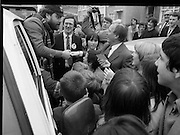 "15/05/1982<br /> 05/15/1982<br /> 15 May 1982<br /> An Taoiseach, Mr Charles Haughey, canvasing with Fianna Fail bye-election candidate Eileen Lemass in Dublin West. Image shows An Taoiseach (centre) meeting comedian Brendan Grace as ""Bottler"" while on the campaign trail."