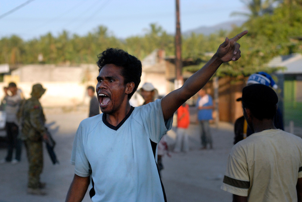 After losing his house and belongings to a random act of arson at Comora, a young man voices his discontent outside the location of Prime Minister Alkartiri's party meeting and press conference. Dili East Timor 04/06/06