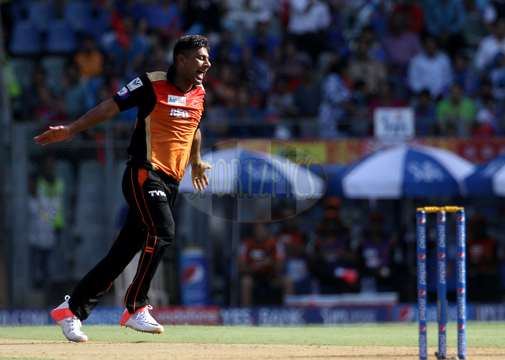 Sunrisers Hyderabad player Praveen Kumar celebrates the wicket Mumbai Indians player Unmukt Chand during match 23 of the Pepsi IPL 2015 (Indian Premier League) between The Mumbai Indians and The Sunrisers Hyderabad held at the Wankhede Stadium in Mumbai India on the 25th April 2015.<br /> <br /> Photo by:  Vipin Pawar / SPORTZPICS / IPL