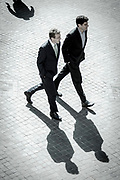 Two men in suits on their way to the NYSE Euronext Stock Exchange on Wall Street.