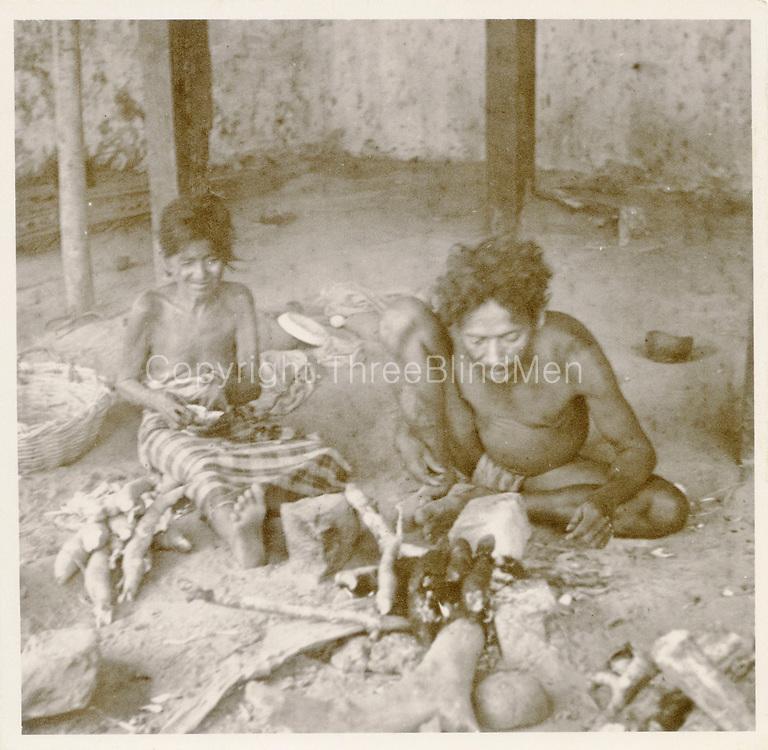 """Vedda and wife (Kavia and Handi) roasting manioc"". R.L. Spittel Colombo."