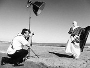 Dame Vivienne Westwood is photographed by Ki Price on Swansea beach naked under the Welsh Flag on June 11, 2014.