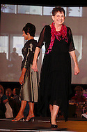 Wearing fashions from Joli, models Lynne Dorn (left) and Dee Crusoe on the runway during A'Wear Affair, the Noble Circle fundraising fashion show, at Sinclair College's David H. Ponitz Center, Saturday, February 23, 2013.  Dorn is an original member of group 1, thriving over 10 years beyond breast cancer.  Crusoe has been thriving two years beyond stage 4 lung cancer.