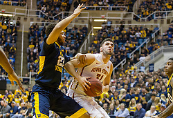 Feb 22, 2016; Morgantown, WV, USA; Iowa State Cyclones forward Georges Niang (31) attempts to make a move around West Virginia Mountaineers forward Esa Ahmad (23) during the first half at the WVU Coliseum. Mandatory Credit: Ben Queen-USA TODAY Sports