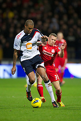 BOLTON, ENGLAND - Saturday, January 21, 2011: Liverpool's Craig Bellamy in action against Bolton Wanderers' Zat Knight during the Premiership match at the Reebok Stadium. (Pic by David Rawcliffe/Propaganda)