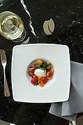 Caprese: burrata tomato, purple basil, flaked salt, olive oil, and aged balsamic vinegar