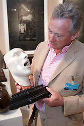 © licensed to London News Pictures. LONDON, UK  08/06/2011. Sculpture expert James Rylands examines an artwork at the Olympia International Fine Art & Antiques Fair. All 30,000 items on sale from 150 dealers are vetted for authenticity by a panel of experts. The show opens in Olympia tomorrow (Thursday) and runs for 11 days. Please see special instructions for usage rates. Photo credit should read CLIFF HIDE/LNP