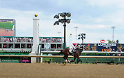 Untapable, ridden by Rosie Napravnik, wins the Longines Kentucky Oaks on Kentucky Oaks Day, Friday, May 2, 2014, in Louisville, Ky.  Longines, the Swiss watch manufacturer known for its luxury timepieces, is the Official Watch and Timekeeper of the 140th annual Kentucky Derby. (Photo by Diane Bondareff/Invision for Longines/AP Images)