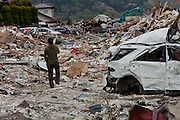 A man looks at the ruined buildings and debris in the city of Ishinomaki, Miyagi prefecture, Japan Friday May 6th 2011. Ishinomaki bore the brunt of the magnitude 9 earthquake that struck the Tohoku coast on March 11th and the town was almost completely destroyed by the large tsunami that followed the quake 20 minutes later