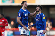 Harry Smith of Macclesfield Townjokes with Reece Cole of Macclesfield Town during the EFL Sky Bet League 2 match between Crawley Town and Macclesfield Town at The People's Pension Stadium, Crawley, England on 23 February 2019.