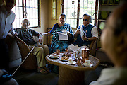 Dr. Vandana Shiva (center) shares a light laugh as she chats over tea with the Minister of Environment, Sr. Jairam Ramesh (seated on her left), in Navdanya office in Dehradun, Uttarakhand, India, on 6th September 2009...Dr. Vandana Shiva, the founder of Navdanya Foundation and Bijavidyapeeth, is a physicist turned environmentalist who campaigns against genetically modified food and teaches farmers to rely on indigenous farming methods.. .Photo by Suzanne Lee / For The National