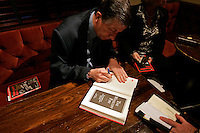 """Sam Heys, co-author of """"The Winecoff Fire: The Untold Story of America?s Deadliest Hotel Fire,"""" signs books at a commemoration to mark the 60th anniversary of the Winecoff Hotel fire in downtown Atlanta. The fire--the deadliest hotel fire in U.S. history--caused departments across the country to update their fire safety codes."""
