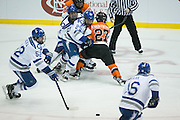 RIT and Air Force players fight for a loose puck during the Atlantic Hockey semifinal at the Blue Cross Arena at the War Memorial in Rochester on Friday, March 18, 2016.