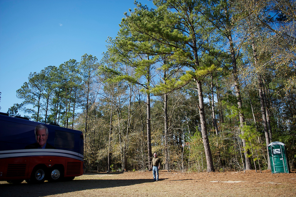 A supporter helps the campaign bus of Republican Presidential candidate Newt Gingrich turn around safely after a town hall rally in Dove Field.  The South Carolina primary is on 21 January.