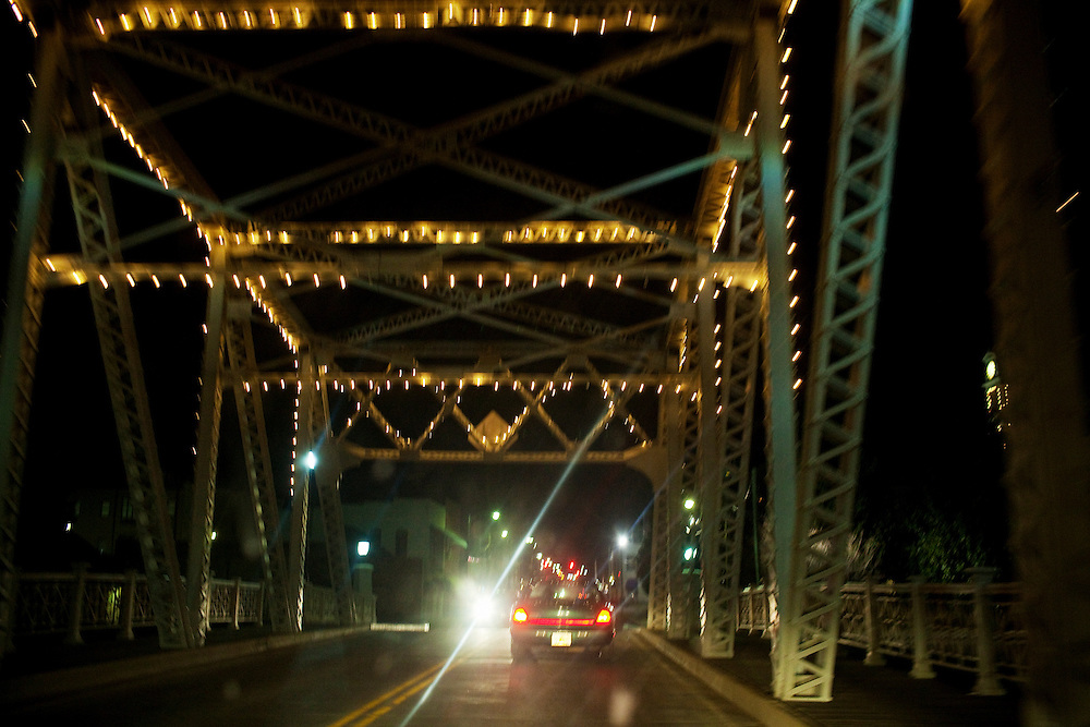 Cars cross the bridge over the Yazoo River that separates North and South Greenwood, Mississippi on February 16, 2011. The town is divided by the river, with most of the city's poor black residents residing on the South side and most of the affluent white residents on the North side. Additional barriers separate factions of the community and harken back to segregation era, including the Baptist Town neighborhood, which is cut off on all sides by train tracks.