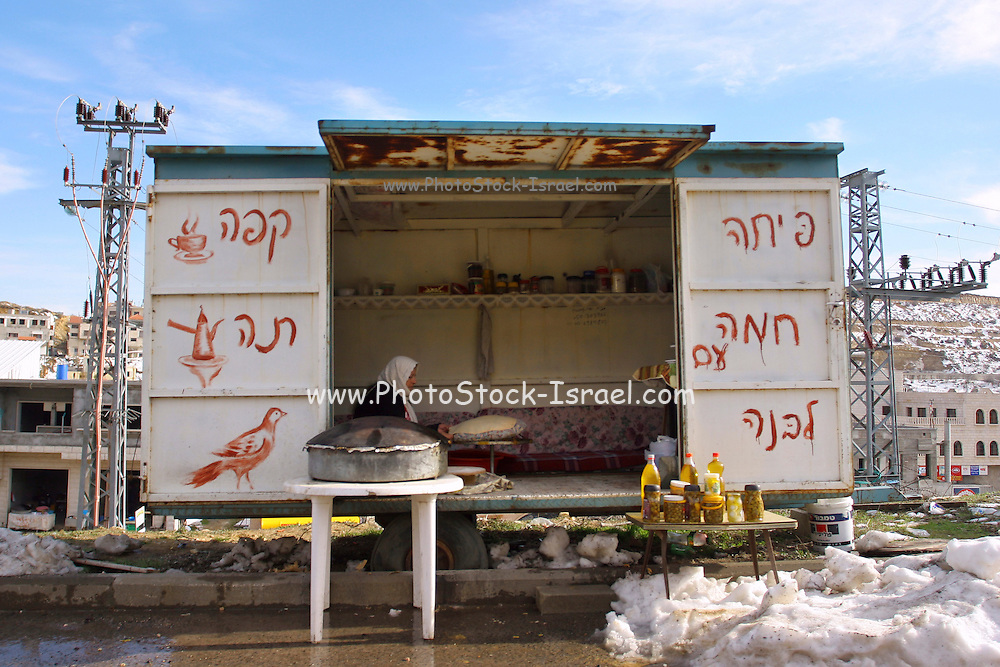 Israel, Golan Heights, The Druze village of Majdal Shams. Families sell veriouse food products as well as Pitah with labaneh, to the visitors to the Hermon site.
