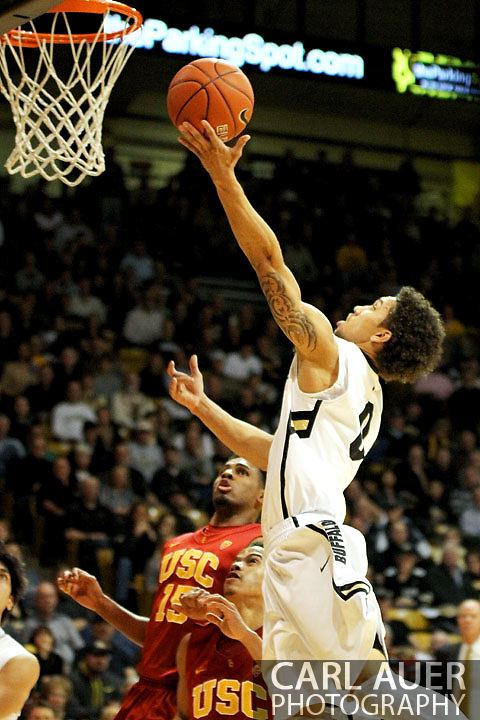 January 10th, 2013: Colorado Buffaloes sophomore guard Askia Booker (0) finger rolls a shot attempt up in the NCAA basketball game between the University of Southern California Trojans and the University of Colorado Buffaloes at the Coors Events Center in Boulder CO