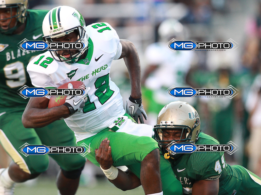 Nov 10, 2012; Birmingham, AL, USA;  UAB Blazers linebacker Chris Rabb (49) tackels Marshall Thundering Herd quarterback Rakeem Cato (12) at Legion Field. Mandatory Credit: Marvin Gentry-