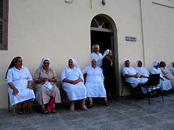 MALTA GOZO MARSALFORN 20JUL06 - Catholic nuns sit outside their retreat at Dar Madre Margherita on the outskirts of Marsalforn, Gozo...jre/Photo by Jiri Rezac..© Jiri Rezac 2006..Contact: +44 (0) 7050 110 417.Mobile:  +44 (0) 7801 337 683.Office:  +44 (0) 20 8968 9635..Email:   jiri@jirirezac.com.Web:    www.jirirezac.com