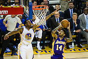 Golden State Warriors forward Andre Iguodala (9) attempts to block a Los Angeles Lakers layup at Oracle Arena in Oakland, Calif., on November 23, 2016. (Stan Olszewski/Special to S.F. Examiner)