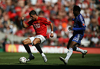 Photo: Rich Eaton.<br /> <br /> Manchester United v Chelsea. FA Community Shield. 05/08/2007. Man UNited's Cristiano Ronaldo tries to get past Chelsea's John Obi Mikel.