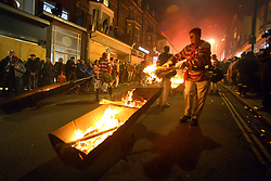© Licenced to London News Pictures. 4-11-2017. Lewes, East Sussex. Lewes bonfire night celebrations, including effigies of Donald Trump, Kim Jong Un and Theresa May, which were later burned during firework displays. One effigy showed a tin of 'Black Zulu' paint - a reference to one societies decision to refrain from 'blacking-up' when dressing as zulu warriors. Photo credit: Peter Cripps/LNP