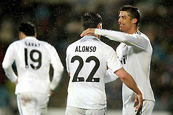 25.03.2010, Coliseum Alfonso Perez, Madrid, ESP, Primera Divison, FC Getafe vs Real Madrid, im Bild Real Madrid's Cristiano Ronaldo  und Xabi Alonso jubeln, EXPA Pictures © 2010, PhotoCredit: EXPA/ Alterphotos/ Alvaro Hernandez / SPORTIDA PHOTO AGENCY