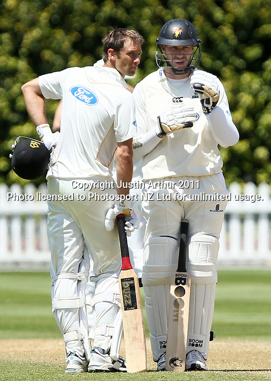 Grant Elliott and Murdoch chat after the over. Plunket Shield cricket - Wellington Firebirds v Otago Volts, day three at Hawkins Basin Reserve, Wellington, New Zealand on Thursday 1 December 2011. Photo: Justin Arthur / photosport.co.nz